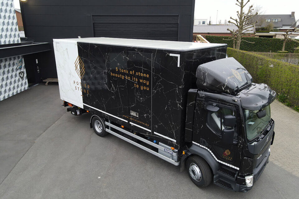 Potier Stone Volvo FL240 custom wrap marble print truck Sjegers Fly High Productions